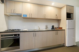 The Kitchen of a One Bedroom Apartment with Spa at the Boulevard Apartments.