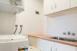 The Laundry of the Three Bedroom Apartment at Boulevard Apartments.