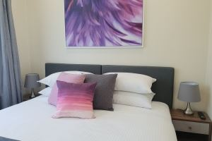 The Bedroom of Mayfield Short Stay Apartments.