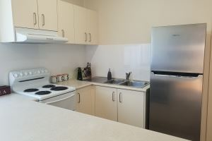 The Kitchen of Mayfield Short Stay Apartments.