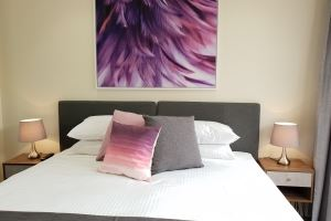 One of the Bedrooms at Mayfield Short Stay Apartments.