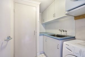 Sandbar Apartment provides a fully equipped laundry.
